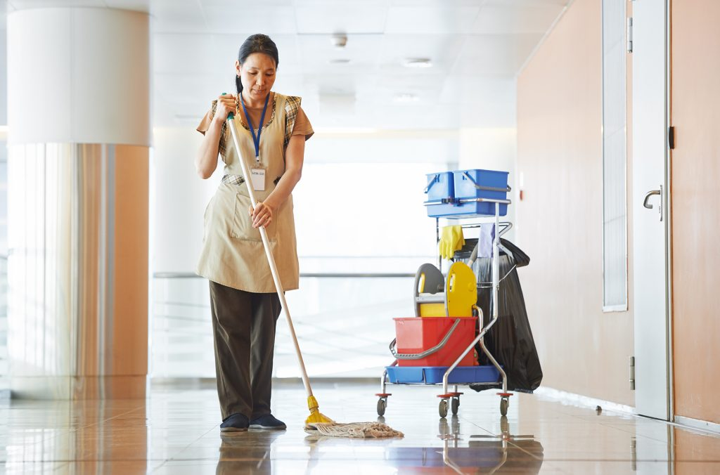 LCM Cleaner mops building entranceway